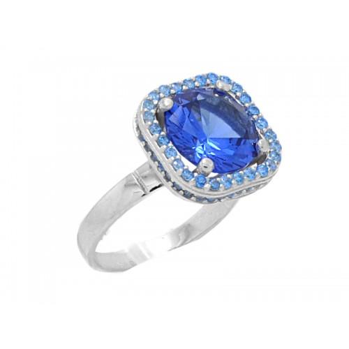 Γυναικείο λευκό δαχτυλίδι με μπλε πέτρα στο κέντρο και γαλάζιες πέτρες