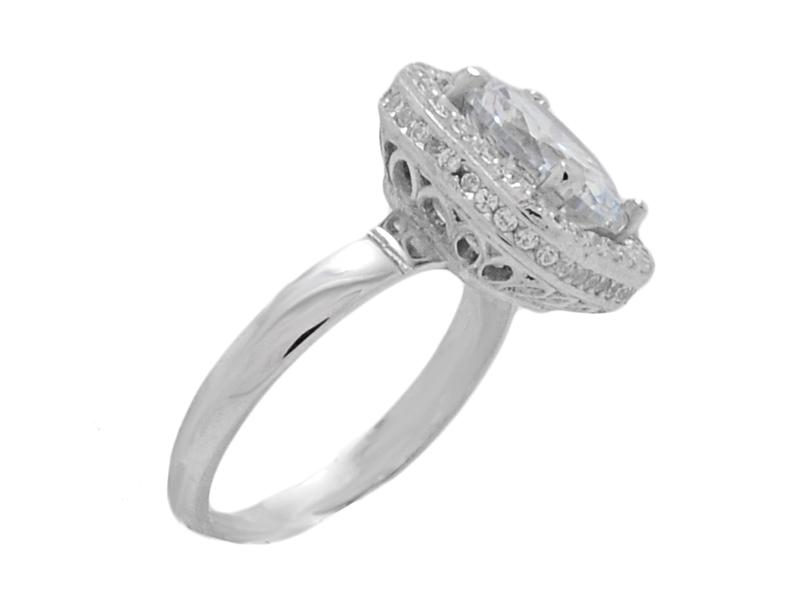 ... Γυναικείο λευκό δαχτυλίδι με μπλε πέτρα στο κέντρο και γαλάζιες πέτρες 29a559ddcaf
