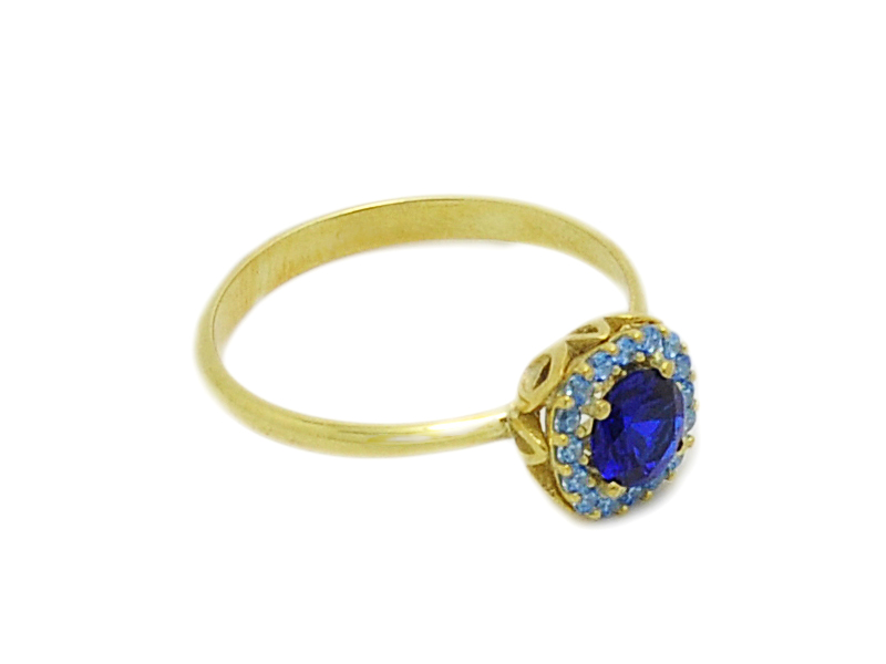 ... Γυναικείο λευκό δαχτυλίδι με μπλε πέτρα στο κέντρο και γαλάζιες πέτρες  ... c05040c494e