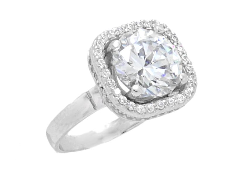 Γυναικείο λευκό δαχτυλίδι με μπλε πέτρα στο κέντρο και γαλάζιες πέτρες eb86b9cca8e